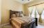 Split Bedrooms with Ceiling Fan, 20x20 Tile, Built in Desk and pot shelf.
