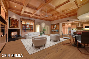 Tradition meets modern in comfortable family room open to kitchen (virtually staged photo)