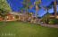 Large grassy yard, citrus trees and central pool oasis