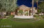 2+ acre lot completed with porte-cochere driveway and water feature