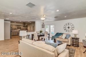 Living, family room with french doors leading out to the pergula patio!