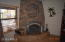 This stone wood burning fireplace provides wonderful heat in the winter.