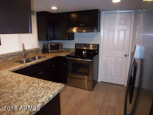 Remodeled! Nice granite counters, stainless sink and appliances.
