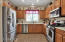 Open Kitchen with Stainless Appliances -Corian Counters-Maple Cabinets-Pantry