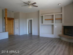 Previous listing photo of great room built ins looking towards front door.