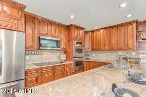 This kitchen is gorgeous! Maple Cabinets, Granite Counters, SS Appliances, Recessed Lighting!
