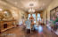 Formal dining with coffered ceiling chandelier and pot lights