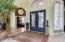 Entry - Double Cantera Door welcomes you guests to a Large Entry