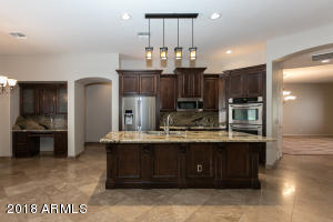 Gourmet Kitchen with Wolf Gas Cooktop & Stainless Appliances