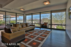 Gorgeous penthouse with stunning views of Camelback Mountain, McDowell Mountain in the glamorous happening community of Optima, walking distance to Scottsdale Fashion Mall and upscale restaurants. Quiet, extreme privacy in your new condo. An easy flowing contemporary unit, 3 bedroom 2 bath, all custom kitchen and interiors. 2 parking spots, TWO relaxing patio's- one off the living and the other off the master. Penthouses rarely go on the market in this very desirable community. Amenities included- Conceirge service, state of the art fitness center, indoor basketball court, indoor lap pool, walking paths, lush green in the heart of the desert. Resort living at its best.