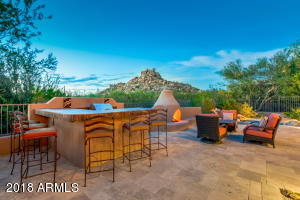 Outdoor bar and built in bbq, travertine pavers throughout, gas kiva fireplace to gather on cool evenings