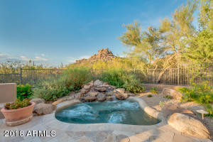 Private resort backyard with oversized spa, water feature, and mountain views!