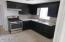 Kitchen with Gas range/oven, refinished cabinets and granite counter tops