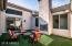 Interior Courtyard, completely enclosed with sliding doors from Foyer and Great Room. Artificial grass and gas fireplace
