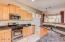 Stainless steel appliance, breakfast bar, maple cabinets, granite counters