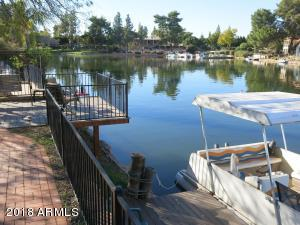 Boat & Fish 52 Acre Lake and 5.5 Miles of Shoreline. Water Views KT, FRM, & 2 BDRS.