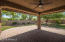 Covered Patio with Ceiling Fan and Pavers