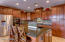 There are plenty of cabinets and counter space in this beautifully equipped kitchen.