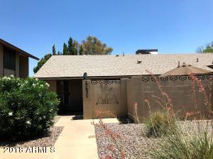 Front elevation featuring beautiful HOA maintained landscaping and enclosed patio.