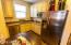 Guest House kitchen has a double door stainless fridge that conveys