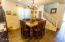 Dining room has a beautiful chandelier and plenty of room. Room is currently divided by sellers bookcase but HUGE when not divided. Many options for this area.
