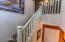 Stairs to second story - master bedroom, 3 bedrooms, and a loft