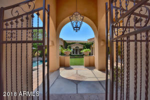 Your guest's jaws will drop as they enter the magical private courtyard with pool, spa, & lawn on the way to the entry of your home. Custom chandelier from Iron Works