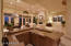 An entertainer's dream with custom Alder cabinetry and seating for five plus bartender!