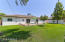 Beautiful grass backyard with paver patio