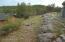 Back corner of lot, set into the hillside