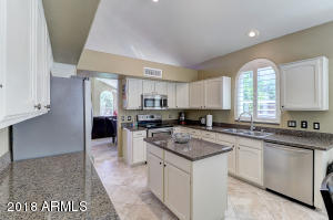 A bright light kitchen with granite counters and Stainless Appliances only one year old.