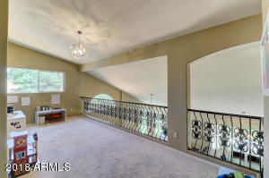 Custom Wrought Iron Railing at loft makes this a perfect office space, play or study area for family.