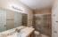 Beautifully remodeled master bath with Travertine tile counter top and shower