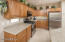 SS appliances, Beech cabinets, engineered stone countertops