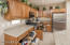 Rollout shelves, built-in spice rack, Lazy Susan, rollout trash and recycle bins, tilt-out drawer