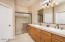 Raised Beech cabinets, tiled countertop/backsplash, dual drop-in sinks, oil-rubbed bronze faucets/accessories, upgraded lighting, large tiled shower