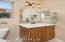 Raised Beech cabinet, tile backsplash, oil-rubbed bronze faucets/accessories, upgraded lighting