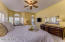 Enjoy your master bedroom suite with sitting area.