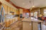 Expansive granite counter space and large kitchen island.