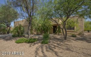 Mature trees and electric gated entry for ultimate privacy.