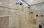 "Rain shower heads accent this enormous ""car wash"" master bath shower!"