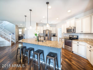 Open Kitchen with Island and Pendent Lighting
