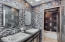 Main bath floor to cieling glass tile