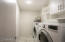 Laundry Room inside the home. W/D purchased 2016, Electric Water Heater purchased 2016