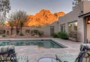 Sit by the pool and watch the mountain change color from the guest house