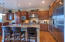 Granite Slab counters, upgraded cabinets, gas range, double ovens, built in refrigerator & microwave.