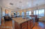 Kitchen overlooks family room fully equipped with gas fireplace, wet bar & wine refrigerator!