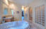 Large soaker tub, walk in snail shower, Dual vanities with raised counter heights