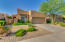 Excellent Curb Appeal with gated front walkway welcomes you.