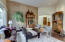 Living Rm welcomes Guests from Impressive 20 ft ceiling foyer